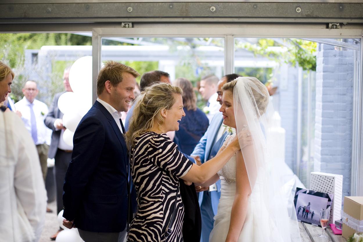 Bruidsfotografie bruiloft felicitaties receptie Como & Co Noordwijkerhout spontane trouwreportage
